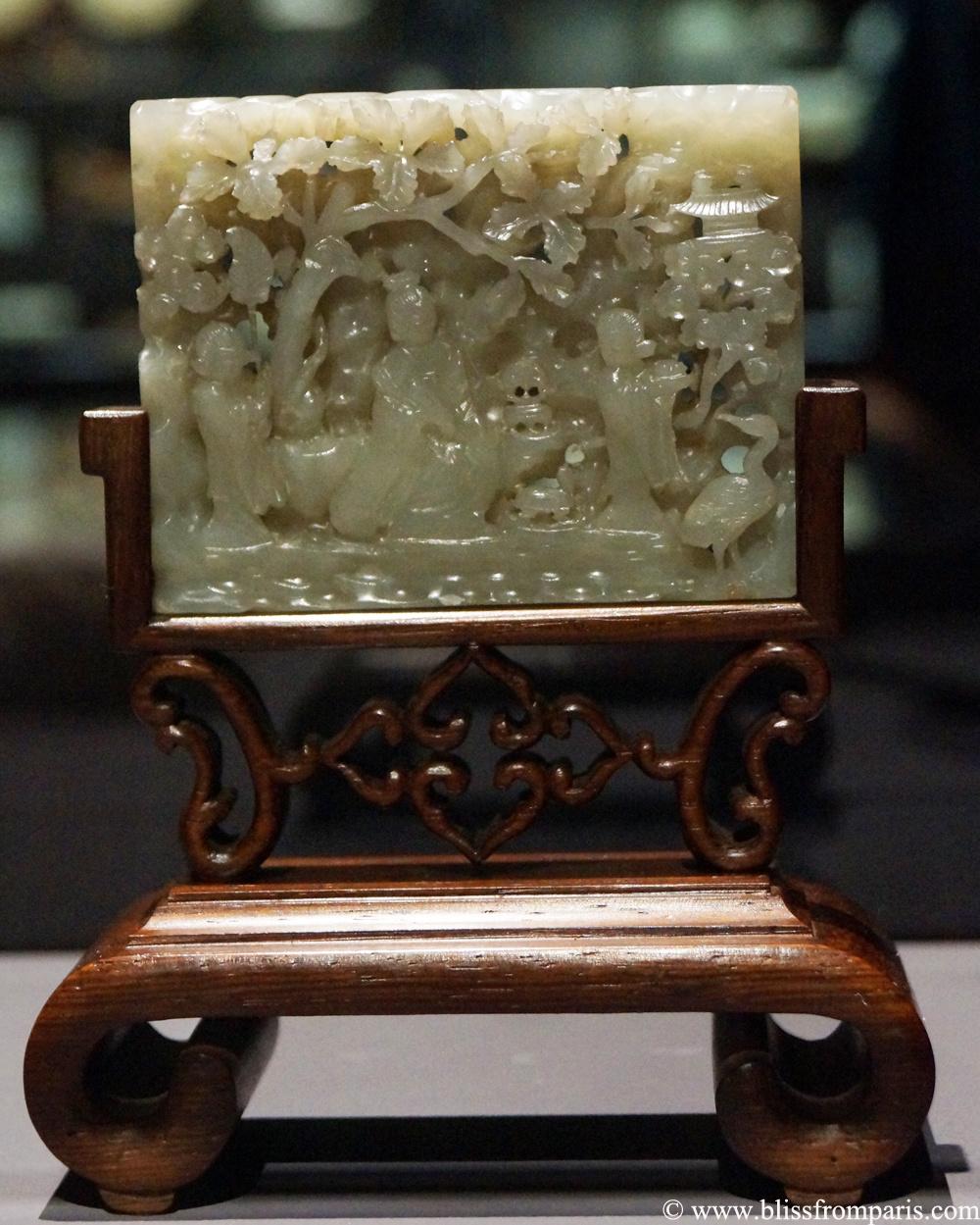 Plaque à décor de personnages, de grue et de tortue, Chine, début de la dynastie Ming, jade, bois