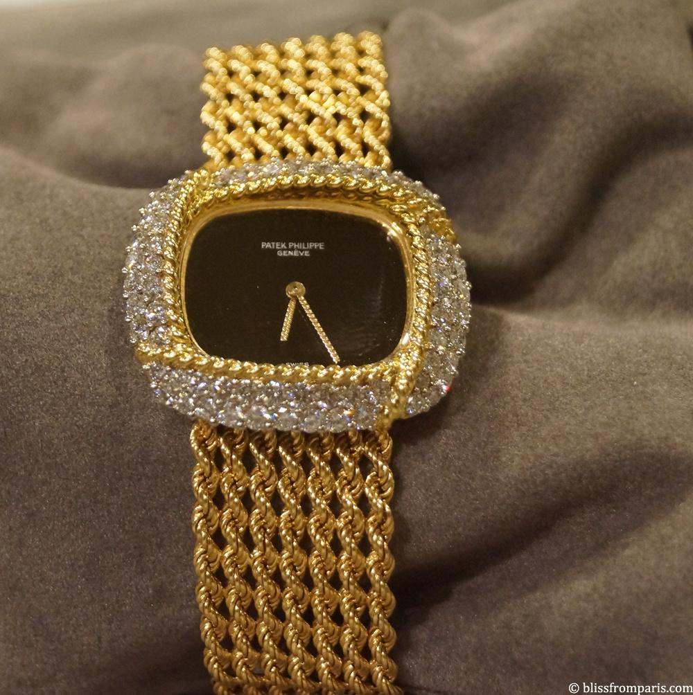 Montre Patek Philippe, or jaune, onyx, diamants